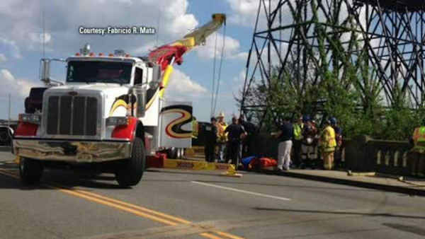 "<div class=""meta ""><span class=""caption-text "">A man escaped unharmed after his truck crashed through a barrier leaving him dangling off of a bridge in Little Ferry Saturday.</span></div>"