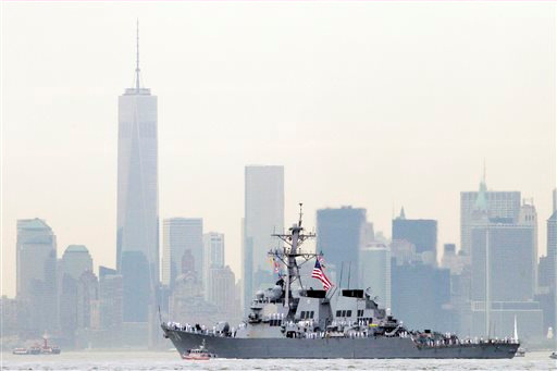 "<div class=""meta image-caption""><div class=""origin-logo origin-image ""><span></span></div><span class=""caption-text"">Sailors line the bow of the destroyer USS McFaul as it glides past One World Trade Center and the lower Manhattan skyline, Wednesday, May 21, 2014 in New York harbor.  (AP/Mark Lennihan )</span></div>"