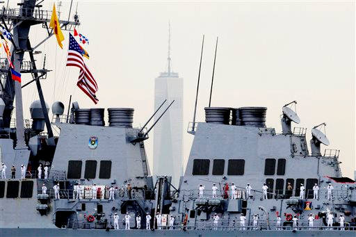 "<div class=""meta image-caption""><div class=""origin-logo origin-image ""><span></span></div><span class=""caption-text"">Sailors line the decks of the destroyer USS Cole as it glides past One World Trade Center, Wednesday, May 21, 2014 in New York.  (AP Photo/Mark Lennihan)</span></div>"