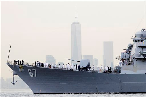 "<div class=""meta image-caption""><div class=""origin-logo origin-image ""><span></span></div><span class=""caption-text"">Sailors line the bow of the destroyer USS Cole as it glides past One World Trade Center and the lower Manhattan skyline, Wednesday, May 21, 2014 in New York.  (AP Photo/Mark Lennihan)</span></div>"