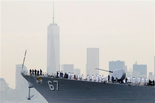 "<div class=""meta image-caption""><div class=""origin-logo origin-image ""><span></span></div><span class=""caption-text"">Close-up of sailors lining the bow of the destroyer USS Cole as it glides past One World Trade Center and the lower Manhattan skyline, Wednesday, May 21, 2014 in New York.  (AP Photo/Mark Lennihan)</span></div>"