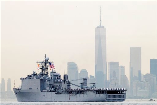 "<div class=""meta image-caption""><div class=""origin-logo origin-image ""><span></span></div><span class=""caption-text"">Sailors line the decks of the dock landing ship USS Oak Hill as it glides past One World Trade Center and the lower Manhattan skyline, Wednesday, May 21, 2014 in New York. (AP Photo/Mark Lennihan)</span></div>"