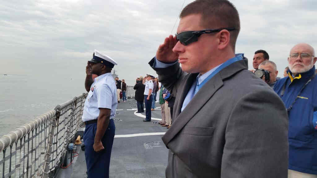 "<div class=""meta image-caption""><div class=""origin-logo origin-image ""><span></span></div><span class=""caption-text"">Medal of Honor recipient Kyle White on U.S. Coast Guard cutter Campbell renders a salute to Ft. Hamilton. (U.S. Army)</span></div>"