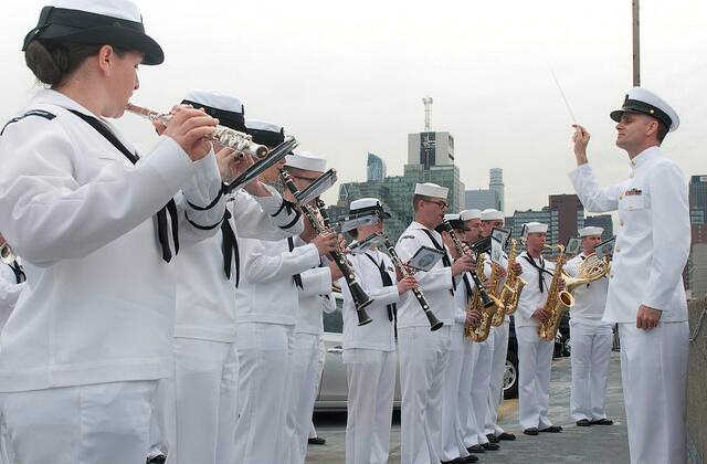 "<div class=""meta image-caption""><div class=""origin-logo origin-image ""><span></span></div><span class=""caption-text"">Navy Band Northeast perform for guests on Pier 92 during the parade of ships. </span></div>"