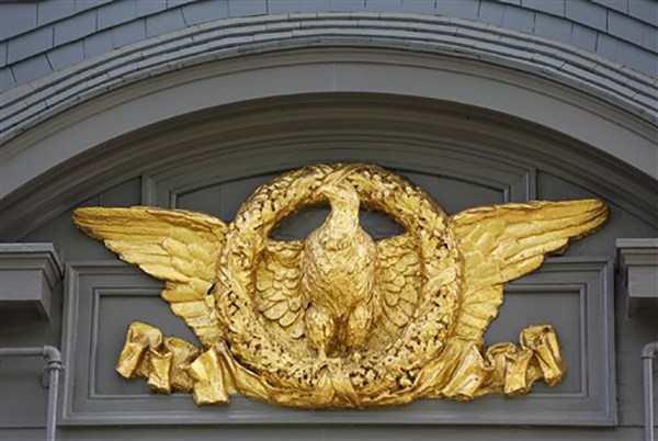 "<div class=""meta image-caption""><div class=""origin-logo origin-image ap""><span>AP</span></div><span class=""caption-text"">A gold-leaf covered eagle on the exterior of President Theodore Roosevelt's 28-room Sagamore Hill mansion that served as his ""Summer White House"" in Oyster Bay, N.Y. (AP Photo/Kathy Willens)</span></div>"