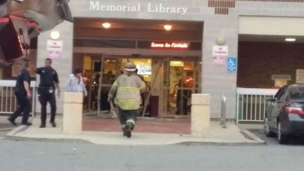 Several people were injured when a car drove into a library in Spring Valley, New York Tuesday evening.  (Photo courtesy @zishey)