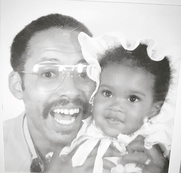 <div class='meta'><div class='origin-logo' data-origin='none'></div><span class='caption-text' data-credit=''>AJ Ross and her father.</span></div>