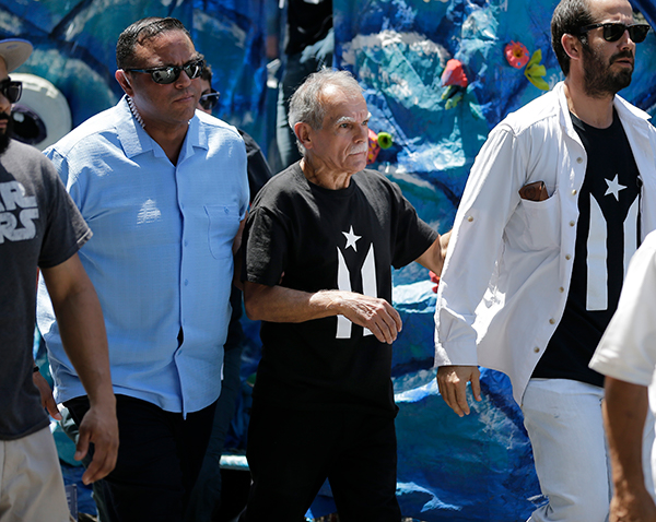 "<div class=""meta image-caption""><div class=""origin-logo origin-image ap""><span>AP</span></div><span class=""caption-text"">Oscar Lopez Rivera, center, leaves the Puerto Rican Day Parade in New York, Sunday, June 11, 2017.  (AP Photo/Seth Wenig)</span></div>"