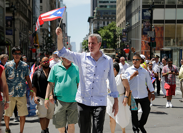 "<div class=""meta image-caption""><div class=""origin-logo origin-image ap""><span>AP</span></div><span class=""caption-text"">New York City Mayor Bill de Blasio marches in the Puerto Rican Day Parade in New York, Sunday, June 11, 2017</span></div>"
