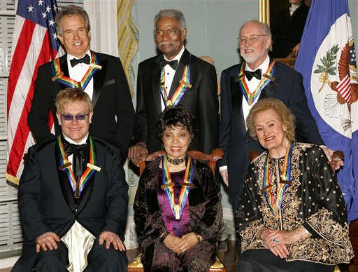 Recipients of the 27th annual Kennedy Center Honors pose for a photo following a dinner celebrating their lifetime achievements in the arts at the State Department on Dec. 4, 2004. <span class=meta>AP Photo/J. Scott Applewhite</span>
