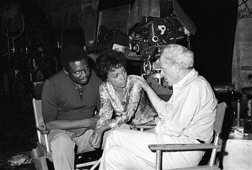 Producer Jules Dassin, on Aug. 12, 1968, &#34;Up Tight,&#34; with its two stars, Julian Mayfield and Ruby Dee. The movieis a drama of betrayal among civil rights militants. <span class=meta>AP Photo/David F. Smith</span>