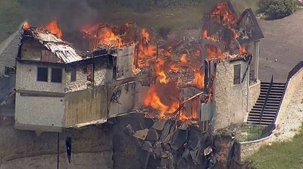Vacant luxury home dangling off a cliff in Central Texas is burned to the ground on Friday, June 13, 2014