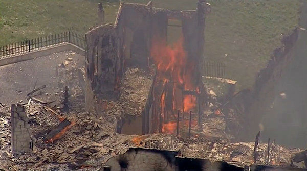 "<div class=""meta image-caption""><div class=""origin-logo origin-image ""><span></span></div><span class=""caption-text"">Vacant luxury home dangling off a cliff in Central Texas is burned to the ground on Friday, June 13, 2014</span></div>"