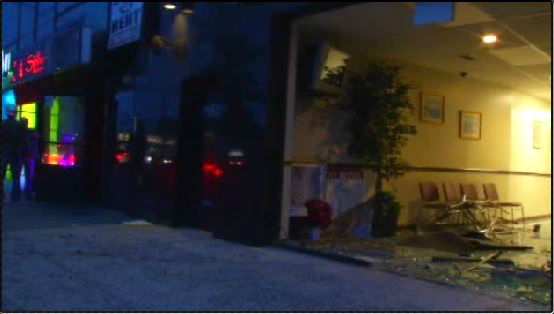 A vehicle hit another car, then jumped a curb and smashed through the front of a tax office. <span class=meta>WABC</span>