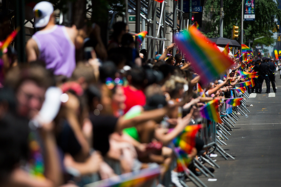 "<div class=""meta image-caption""><div class=""origin-logo origin-image ap""><span>AP</span></div><span class=""caption-text"">Members of the crowd line the street with rainbow flags as they watch the New York City Pride Parade on Sunday, June 25, 2017 in New York. (AP Photo/Michael Noble Jr.)</span></div>"