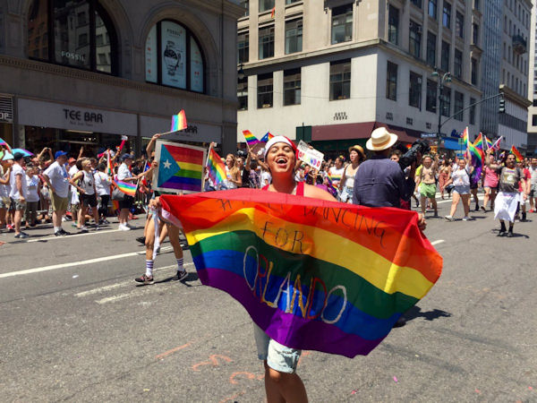"""<div class=""""meta image-caption""""><div class=""""origin-logo origin-image none""""><span>none</span></div><span class=""""caption-text"""">New York City's gay pride parade headed down Fifth Avenue Sunday, ending in Greenwich Village.</span></div>"""