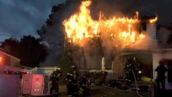 "<div class=""meta image-caption""><div class=""origin-logo origin-image none""><span>none</span></div><span class=""caption-text"">Firefighters battled a fire that tore through a home in Deer Park, Long Island early Sunday morning.</span></div>"