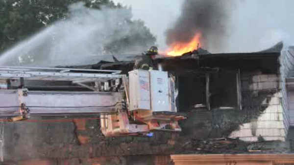 """<div class=""""meta image-caption""""><div class=""""origin-logo origin-image none""""><span>none</span></div><span class=""""caption-text"""">Firefighters battled a fire that tore through a home in Deer Park, Long Island early Sunday morning.</span></div>"""