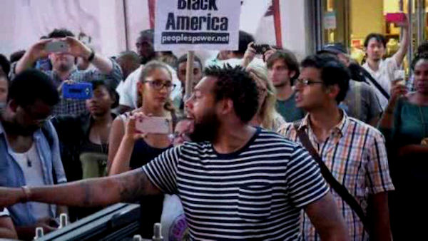 <div class='meta'><div class='origin-logo' data-origin='WABC'></div><span class='caption-text' data-credit=''>A large group of Black Lives Matters supporters gathered in Times Square on Thursday night in response to the recent  police shootings of Alton Sterling and Philando Castile.</span></div>