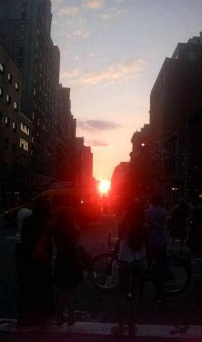 "<div class=""meta image-caption""><div class=""origin-logo origin-image ""><span></span></div><span class=""caption-text"">Eyewitness News viewers sent us their photos of Manhattanhenge, where the sunset aligns with Manhattan's grid, creating a glow down every cross street.   (@Melissa_WC)</span></div>"