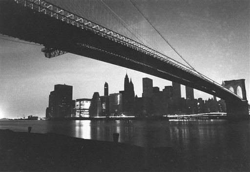 <div class='meta'><div class='origin-logo' data-origin='AP'></div><span class='caption-text' data-credit='AP Photo/Ray Stubblebine, File'>The buildings of Manhattan's financial district are dark during the blackout of July 13, 1977 in this file photo taken from under the Brooklyn Bridge.</span></div>