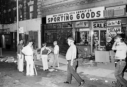 <div class='meta'><div class='origin-logo' data-origin='AP'></div><span class='caption-text' data-credit='AP Photo'>Owners and employees of a sporting goods store stand guard outside with baseball bats after the store on New York City's Upper West Side was looted.</span></div>