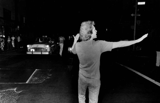 "<div class=""meta image-caption""><div class=""origin-logo origin-image ap""><span>AP</span></div><span class=""caption-text"">A young man directs traffic in midtown Manhattan, July 13, 1977, after New York City was hit by a major power blackout. (AP Photo)</span></div>"