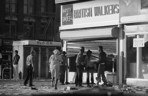 <div class='meta'><div class='origin-logo' data-origin='AP'></div><span class='caption-text' data-credit='AP Photo/Ed Bailey'>Looters in Manhattan's Harlem section reach past a bent security gate to ransack the window of a shoe store. New York Mayor Abraham Beame said some 2,000 people were arrested.</span></div>