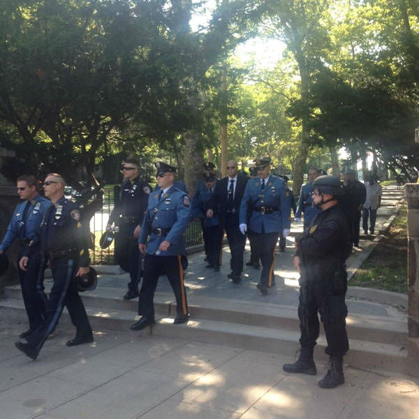 <div class='meta'><div class='origin-logo' data-origin='none'></div><span class='caption-text' data-credit=''>Photos from the funeral of Officer Melvin Santiago in Jersey City on Friday, July 18, 2014. (Toni Yates via Twitter)</span></div>