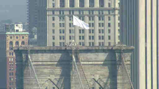 <div class='meta'><div class='origin-logo' data-origin='none'></div><span class='caption-text' data-credit=''>Two American Flags that usually fly over the Brooklyn Bridge were replaced with white flags on July 22, 2014.</span></div>