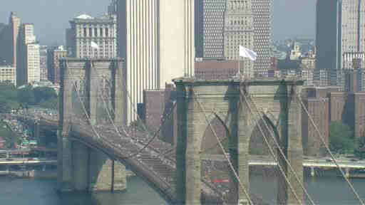 Aluminum foil pans were used to cover up lights when suspects changed out the flags that fly over the Brooklyn Bridge. <span class=meta></span>
