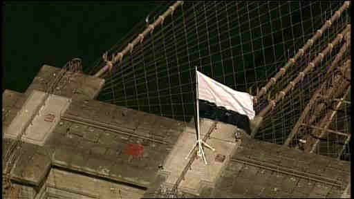 Two American Flags that usually fly over the Brooklyn Bridge were replaced with white flags on July 22, 2014. <span class=meta></span>