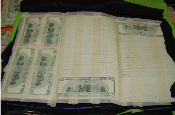 Photos of counterfeit money seized at JFK Airport on July 15 and 16, 2014.