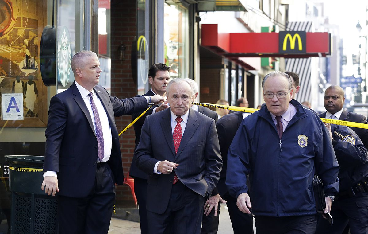 <div class='meta'><div class='origin-logo' data-origin='AP'></div><span class='caption-text' data-credit='AP Photo/Mark Lennihan'>New York Police Department Commissioner William Bratton, center, walks to the scene of a fatal shooting, Monday, Nov. 9, 2015, in New York.</span></div>