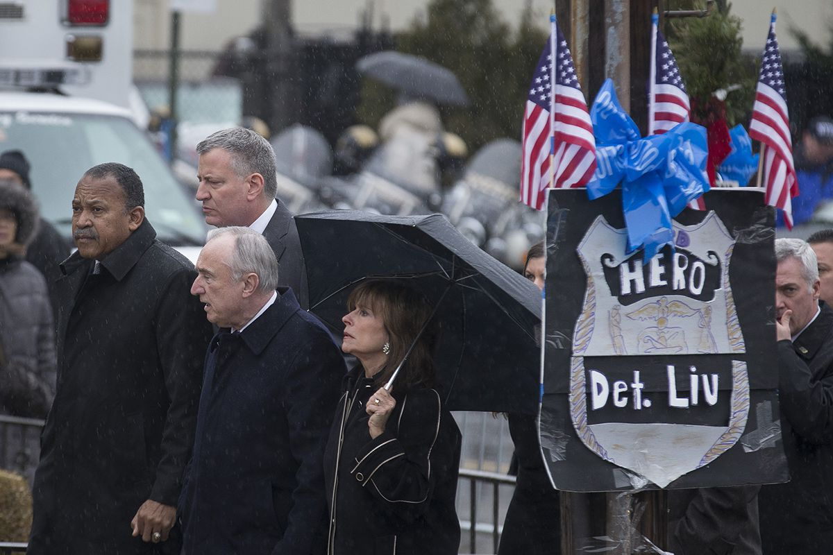 <div class='meta'><div class='origin-logo' data-origin='AP'></div><span class='caption-text' data-credit='AP Photo/John Minchillo'>NYPD Commissioner Bill Bratton, his wife and other officials arrive at the wake of NYPD Officer Wenjian Liu at Aievoli Funeral Home, Saturday, Jan. 3, 2015, in Brooklyn.</span></div>