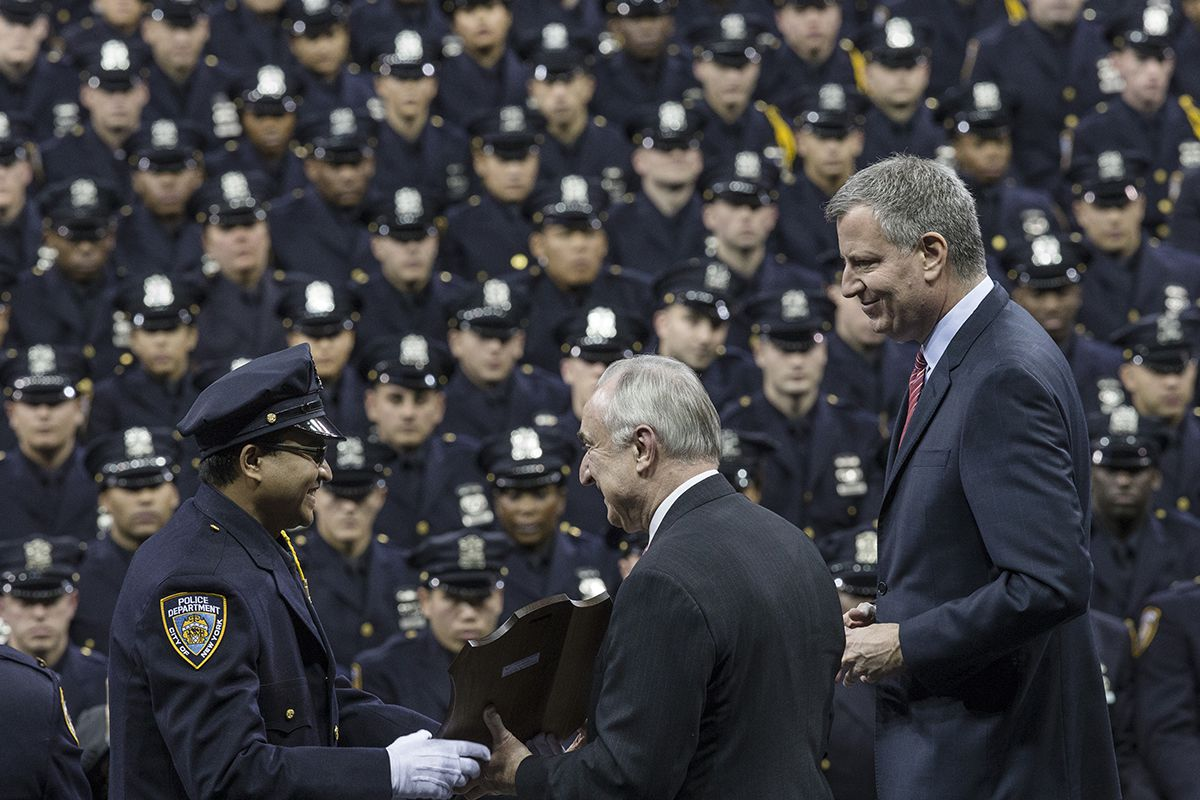 <div class='meta'><div class='origin-logo' data-origin='AP'></div><span class='caption-text' data-credit='AP Photo/John Minchillo'>NYC Mayor Bill de Blasio, right, and police commissioner Bill Bratton, center, present an award to a recruit during a NY Police Academy graduation ceremony, Monday, Dec. 29, 2014.</span></div>