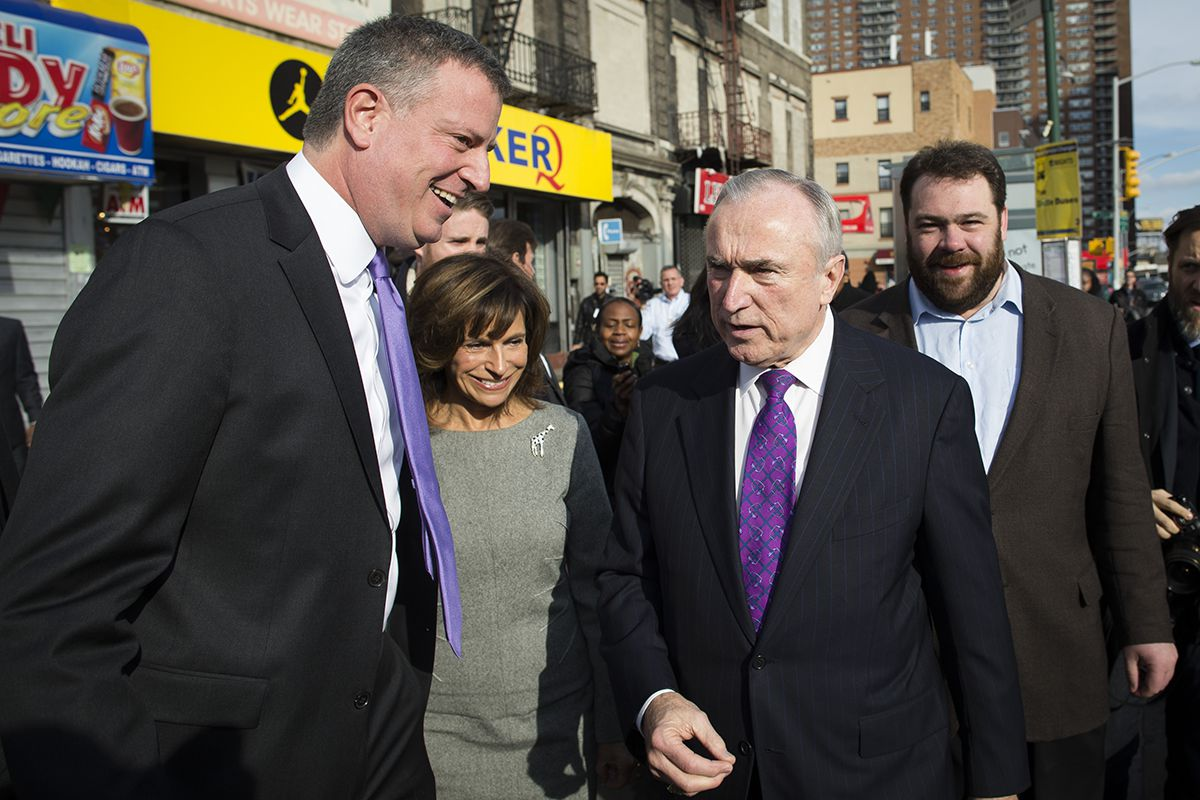 <div class='meta'><div class='origin-logo' data-origin='AP'></div><span class='caption-text' data-credit='AP Photo/John Minchillo'>NYC Mayor-elect Bill de Blasio, left, and newly-named police commissioner William Bratton, center right, speak following a tribute to Nelson Mandela Dec. 7, 2013.</span></div>