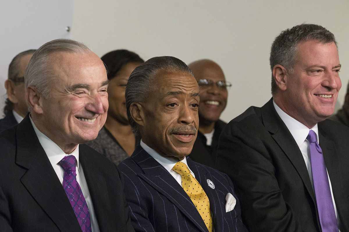 <div class='meta'><div class='origin-logo' data-origin='AP'></div><span class='caption-text' data-credit='AP Photo/John Minchillo'>Rev. Al Sharpton sits between newly-named New York police commissioner William Bratton, left, and Mayor-elect Bill de Blasio, right, on Saturday, Dec. 7, 2013.</span></div>