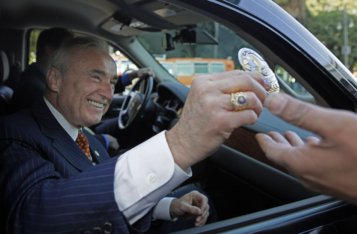 <div class='meta'><div class='origin-logo' data-origin='AP'></div><span class='caption-text' data-credit='AP Photo/Reed Saxon'>Outgoing Los Angeles Police Chief William Bratton hands in his badge as he prepares to leave at an &#34;End Of Watch&#34; ceremony, at police headquarters in Los Angeles Oct. 28, 2009.</span></div>