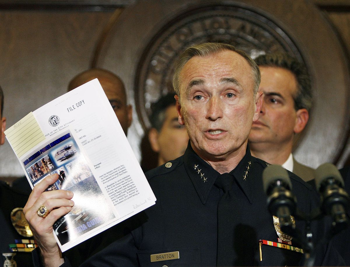 <div class='meta'><div class='origin-logo' data-origin='AP'></div><span class='caption-text' data-credit='AP Photo/Kevork Djansezian'>Los Angeles police Chief William J. Bratton holds the department's media guideline during a news conference with city leaders at Los Angeles City Hall Wednesday, May 2, 2007.</span></div>