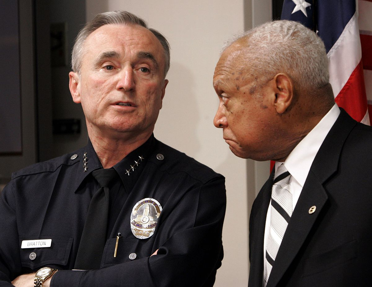<div class='meta'><div class='origin-logo' data-origin='AP'></div><span class='caption-text' data-credit='AP Photo/Nick Ut'>In this Tuesday, Jan. 31, 2006 file photo, former Los Angeles Police Chief William Bratton, left, speaks as then Los Angeles Police Commission president John Mack listens.</span></div>