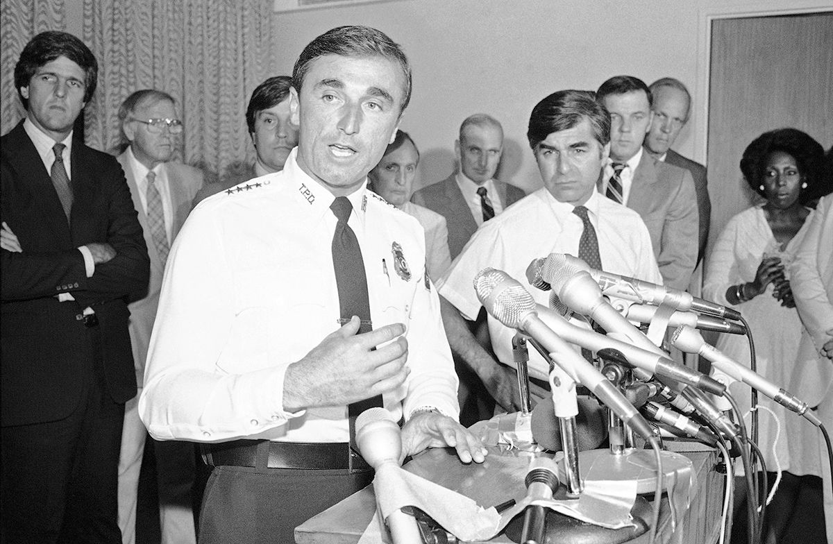 <div class='meta'><div class='origin-logo' data-origin='AP'></div><span class='caption-text' data-credit='AP Photo'>Mass. Bay Transportation Authority Police Chief William J. Bratton, left, answers questions at a news conference at the McCormack Building in Boston on Wednesday, July 20, 1983.</span></div>