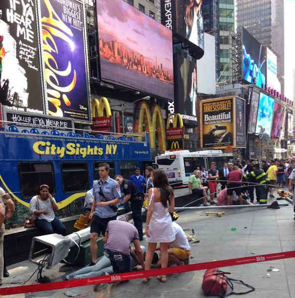 "<div class=""meta image-caption""><div class=""origin-logo origin-image ""><span></span></div><span class=""caption-text"">Two double decker sight seeing buses collided on the East side of the TKTS booth in Times Square.</span></div>"