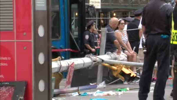Two double decker sight seeing buses collided on the East side of the TKTS booth in Times Square. <span class=meta></span>