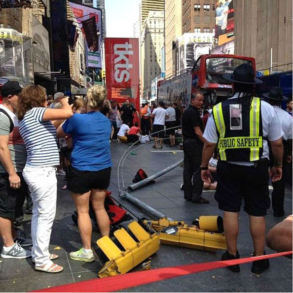 "<div class=""meta image-caption""><div class=""origin-logo origin-image ""><span></span></div><span class=""caption-text"">Two double decker sight seeing buses collided on the East side of the TKTS booth in Times Square.  (Photo courtesy: @lindsaypelcher)</span></div>"