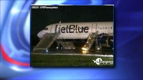 A JetBlue flight headed to JFK Airport from San Juan, Puerto Rico was evacuated after the left engine caught on fire Saturday night. <span class=meta></span>