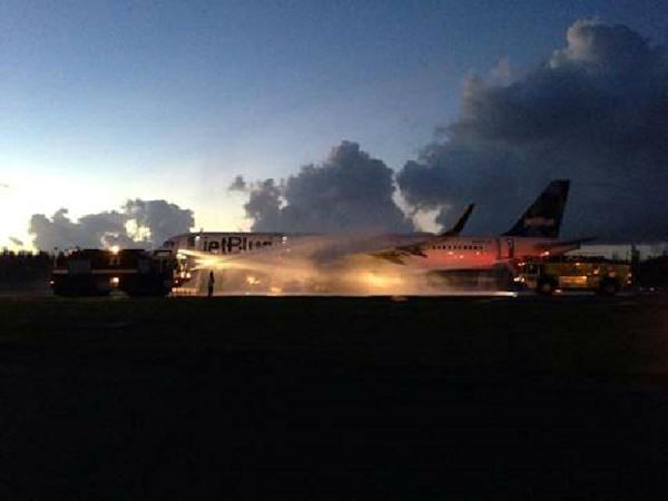 A JetBlue flight headed to JFK Airport from San Juan, Puerto Rico was evacuated after the left engine caught on fire Saturday night. <span class=meta>Photo courtesy: Raymond Talavera</span>