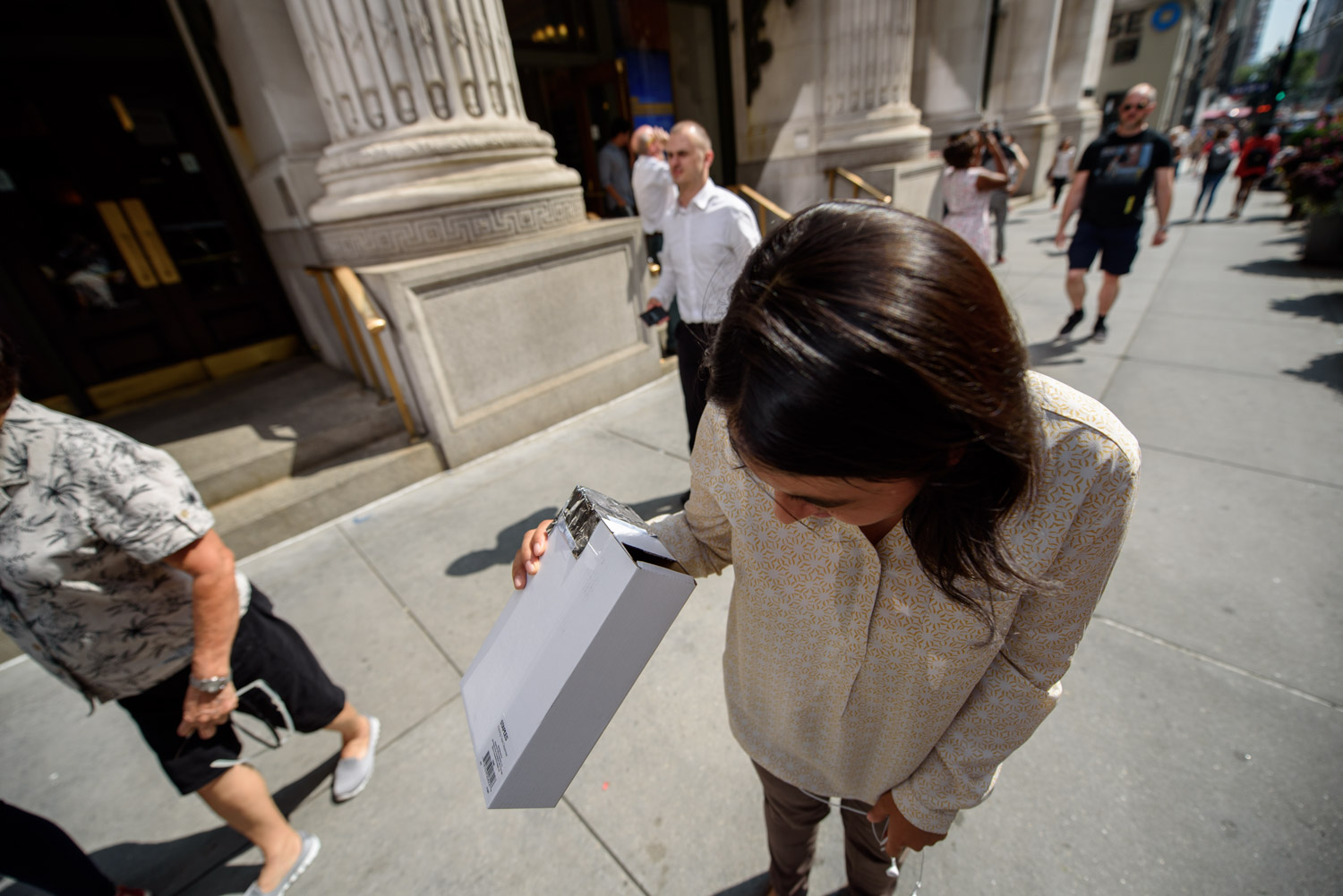 <div class='meta'><div class='origin-logo' data-origin='WABC'></div><span class='caption-text' data-credit='WABC Photo/Mike Waterhouse'>People in Midtown Manhattan paused for a moment and used a reflective box viewer to watch the solar eclipse on Monday, Aug. 21, 2017.</span></div>