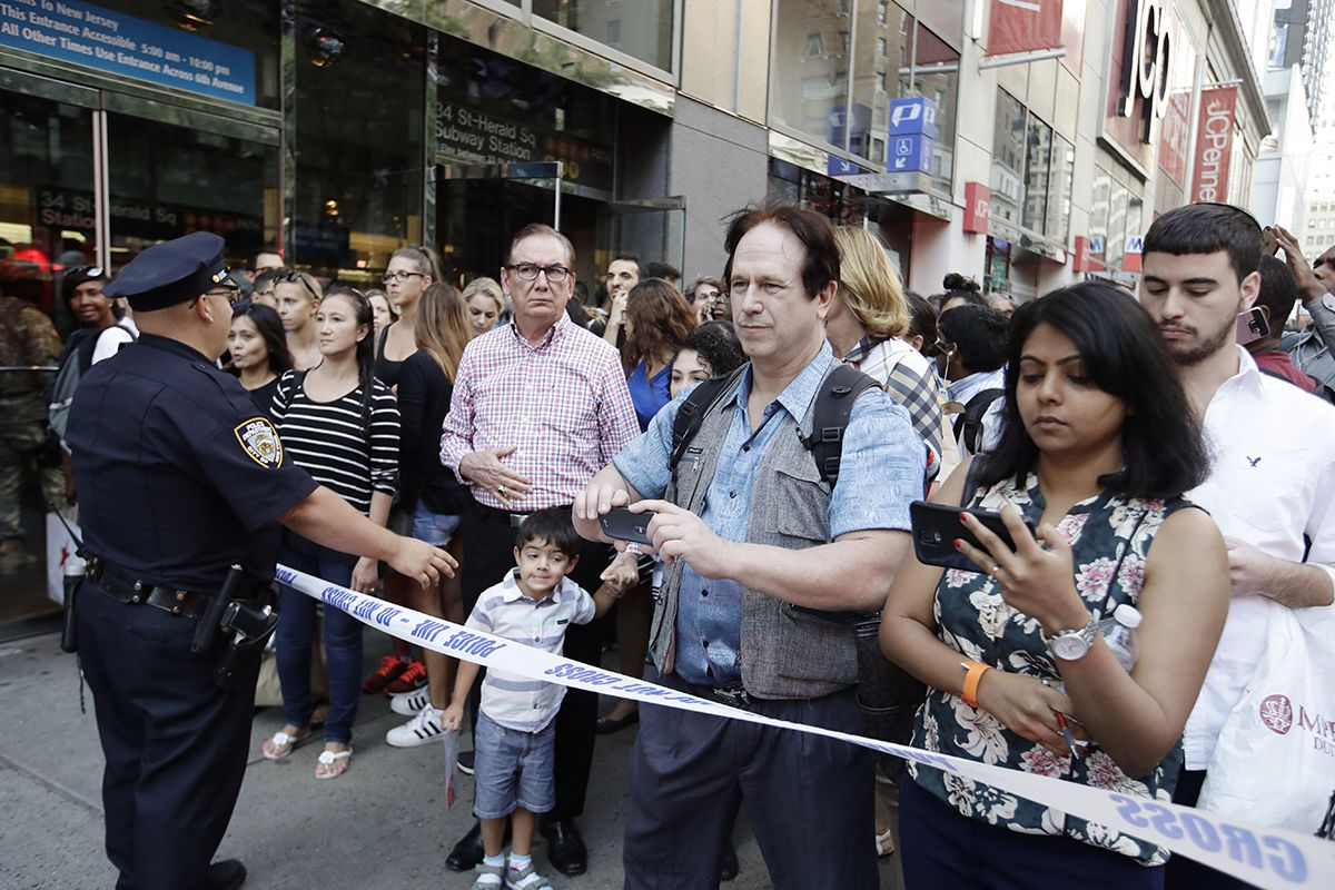 <div class='meta'><div class='origin-logo' data-origin='AP'></div><span class='caption-text' data-credit='AP Photo/Frank Franklin II'>A police officer keeps pedestrians away from west 32nd street Thursday, Sept. 15, 2016, in New York.</span></div>