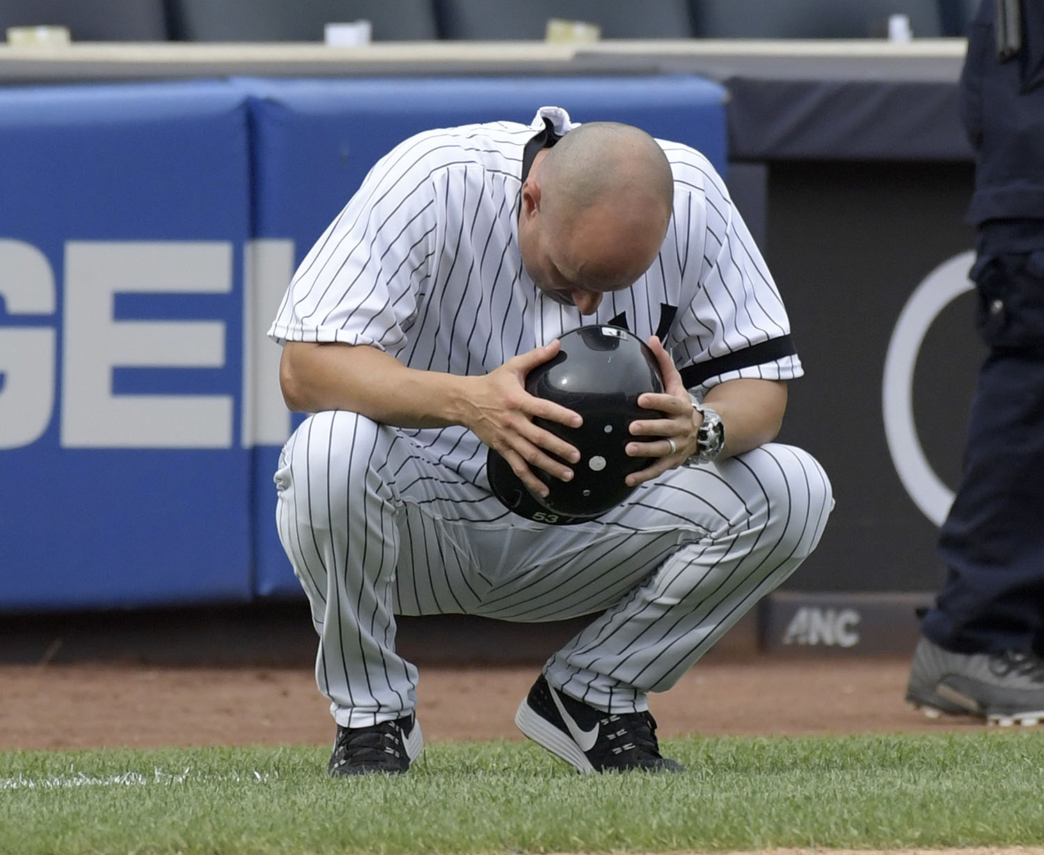 <div class='meta'><div class='origin-logo' data-origin='AP'></div><span class='caption-text' data-credit='AP Photo/Bill Kostroun'>New York Yankees third base coach Joe Espada reacts after a young girl was hit by a line drive during the fifth inning of a baseball game against the Minnesota Twins.</span></div>